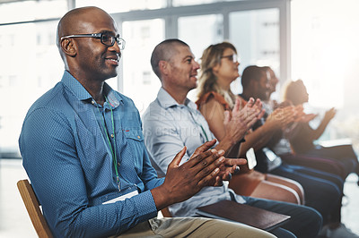 Buy stock photo Shot of a diverse group of creative employees applauding inside