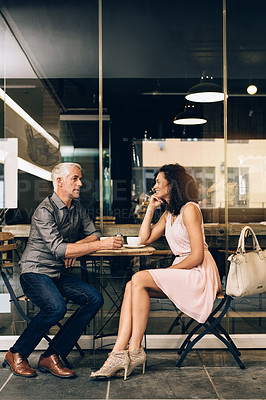Buy stock photo Shot of a mature couple on a coffee date