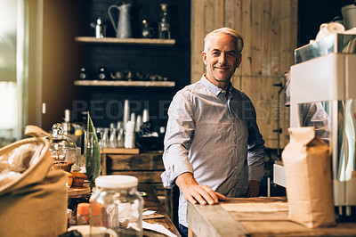 Buy stock photo Portrait of a confident mature man working in a coffee shop