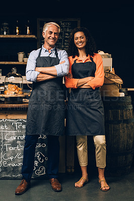 Buy stock photo Portrait of a confident mature man and woman working in a coffee shop