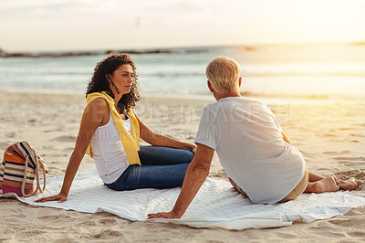 Buy stock photo Shot of a mature couple on a romantic date at the beach