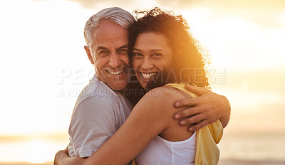 Buy stock photo Portrait of a happy mature couple embracing at the beach