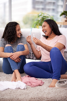 Buy stock photo Cropped shot of two teenage girls talking about menstruation at home
