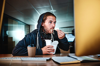 Buy stock photo Cropped shot of a young businessman working late at night in the office