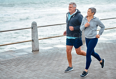 Buy stock photo Shot of a mature couple exercising together outdoors