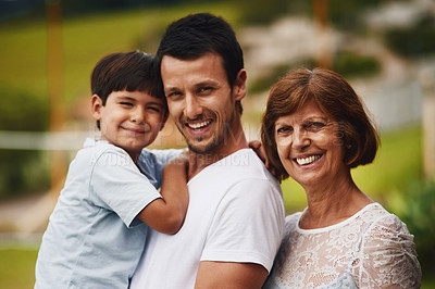 Buy stock photo Portrait of a young man spending time with his mother and son at the park