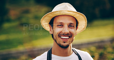 Buy stock photo Portrait of a handsome young man working in a garden