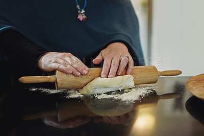 Buy stock photo Cropped shot of an unrecognizable mature woman baking in the kitchen