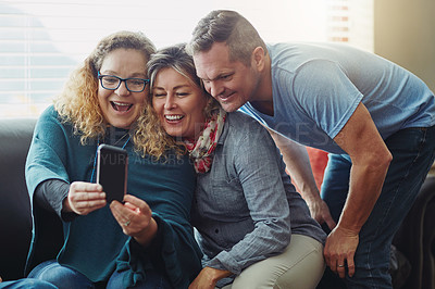 Buy stock photo Cropped shot of an affectionate family taking selfies at their get together