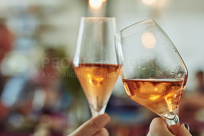 Buy stock photo Closeup shot of two wine glasses being clinked to make a toast