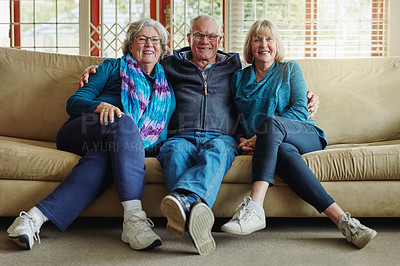 Buy stock photo Full length portrait of an affectionate family sitting on a sofa at home
