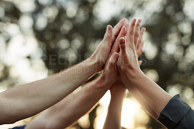 Buy stock photo Shot of a group of unrecognizable people high fiving