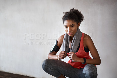 Buy stock photo Cropped portrait of an attractive young woman exercising outdoors in the city