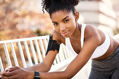 Buy stock photo Cropped portrait of an attractive young woman taking a break during her workout in the city