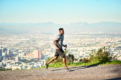 Buy stock photo Full length shot of a handsome and athletic young man exercising outdoors