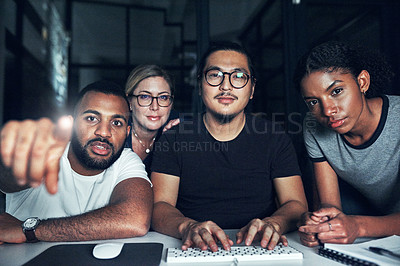 Buy stock photo Shot of a group of businesspeople connecting to a user interface in an office at night