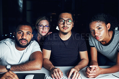 Buy stock photo Shot of a group of businesspeople working together in an office at night