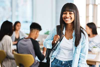 Buy stock photo Portrait of a happy young student standing with her study group in the background