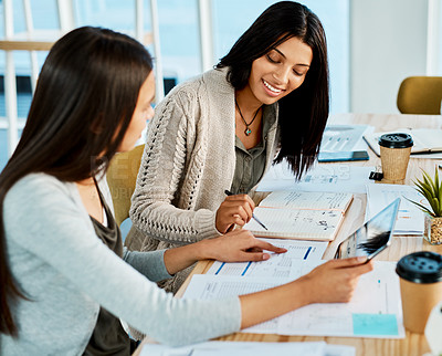 Buy stock photo Shot of two young women studying together at university