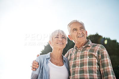 Buy stock photo Shot of a happy senior couple enjoying a day in the park
