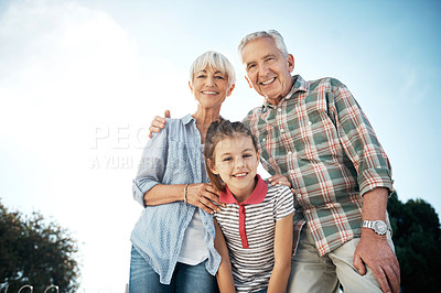Buy stock photo Portrait of an adorable little girl spending time with her grandparents in the park