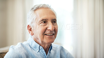 Buy stock photo Cropped shot of a senior man sitting on the sofa at home