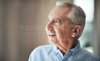 Buy stock photo Cropped shot of a senior man looking thoughtful while standing in his home