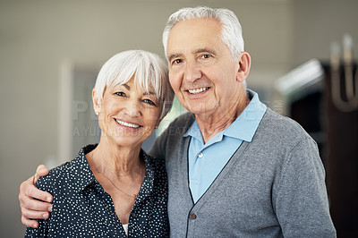 Buy stock photo Cropped portrait of an affectionate senior couple standing in their home