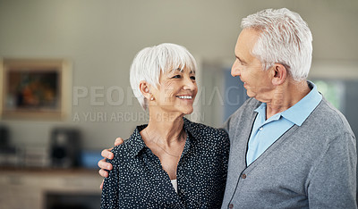 Buy stock photo Cropped shot of an affectionate senior couple standing face to face in their home
