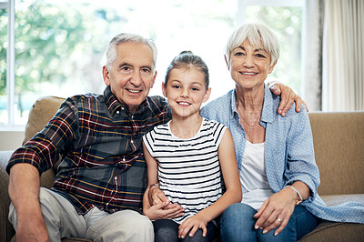 Buy stock photo Portrait of an adorable little girl spending time with her grandparents at home