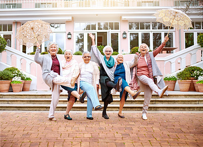 Buy stock photo Shot of a group of quirky senior friends messing around outdoors