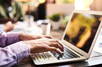 Buy stock photo Closeup shot of an unrecognizable businessman working on a laptop at a cafe