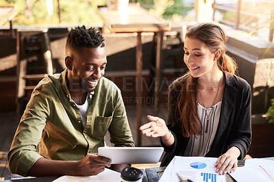 Buy stock photo Shot of two designers having a meeting at a coffee shop