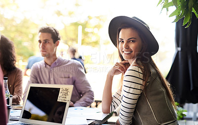 Buy stock photo Portrait of a young designer having a meeting with her colleagues at a coffee shop
