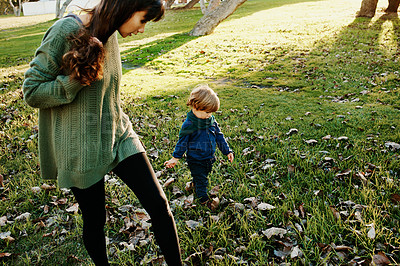 Buy stock photo Shot of a single mother spending some time at the park with her son