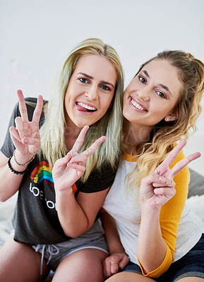 Buy stock photo Shot of two girlfriends spending some time together at home