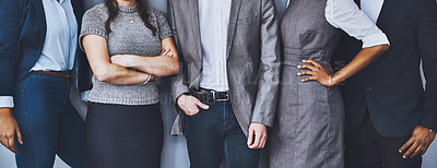 Buy stock photo Cropped shot of a group of unrecognizable businesspeople waiting in line for their interviews