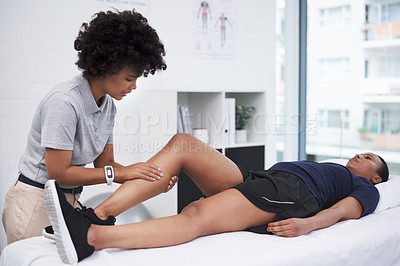 Buy stock photo Shot of a physiotherapist working with a patient in a rehabilitation center