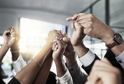 Buy stock photo Closeup shot of an unrecognizable group of businesspeople holding hands together in solidarity