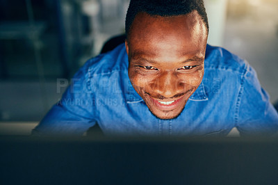 Buy stock photo Cropped shot of a young handsome businessman working late in the office