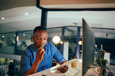 Buy stock photo Cropped shot of a young handsome businessman smoking an electronic cigarette while working late in the office