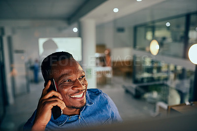 Buy stock photo Cropped shot of a young handsome man on a call while working late in the office