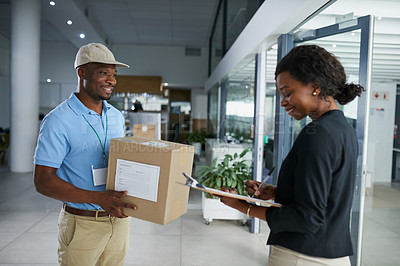 Buy stock photo Shot of a young woman signing for her delivery from the courier in an office