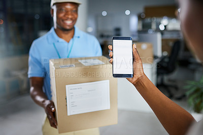 Buy stock photo Shot of a woman using a mobile phone when receiving a delivery from the courier in an office