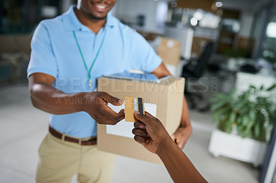 Buy stock photo Cropped shot of a woman using a credit card to pay for a delivery from the courier in an office