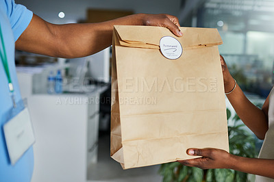 Buy stock photo Cropped shot of a man delivering an order of fast food to a customer in an office