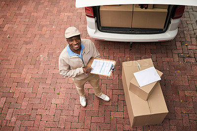 Buy stock photo High angle portrait of a young man making a deliveries with a delivery van