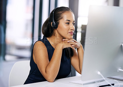 Buy stock photo Shot of a happy young woman working in a modern call centre