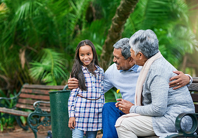 Buy stock photo Cropped portrait of an adorable little girl enjoying the day outdoors with her grandparents