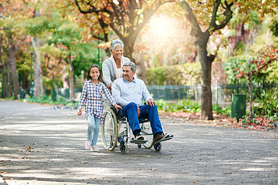 Buy stock photo Full length shot of an adorable little girl enjoying the day outdoors with her grandparents